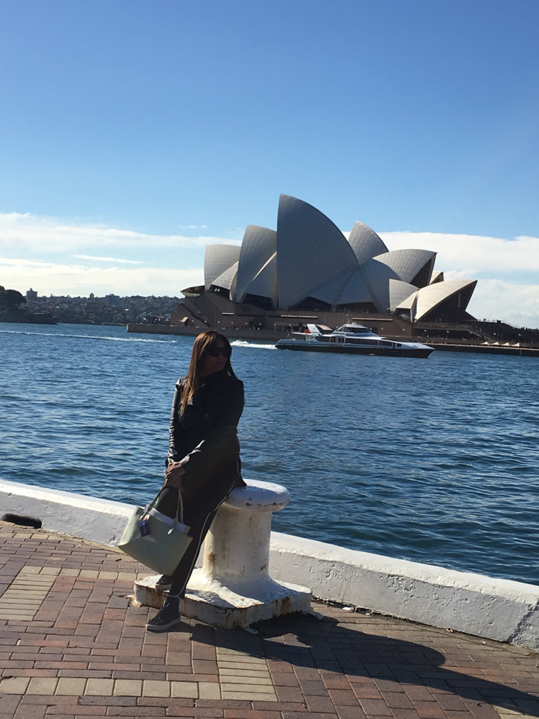 Queen of K in posing in front of Sydney Opera House