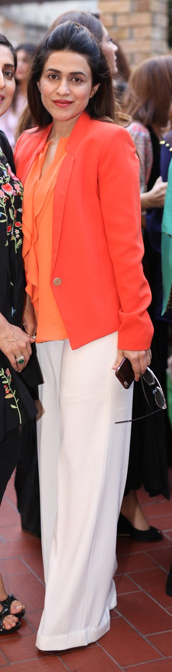 Madiha Abrar - Mixing different shades of orange, and adding classic white pants to to the mix, make this look a total winner!