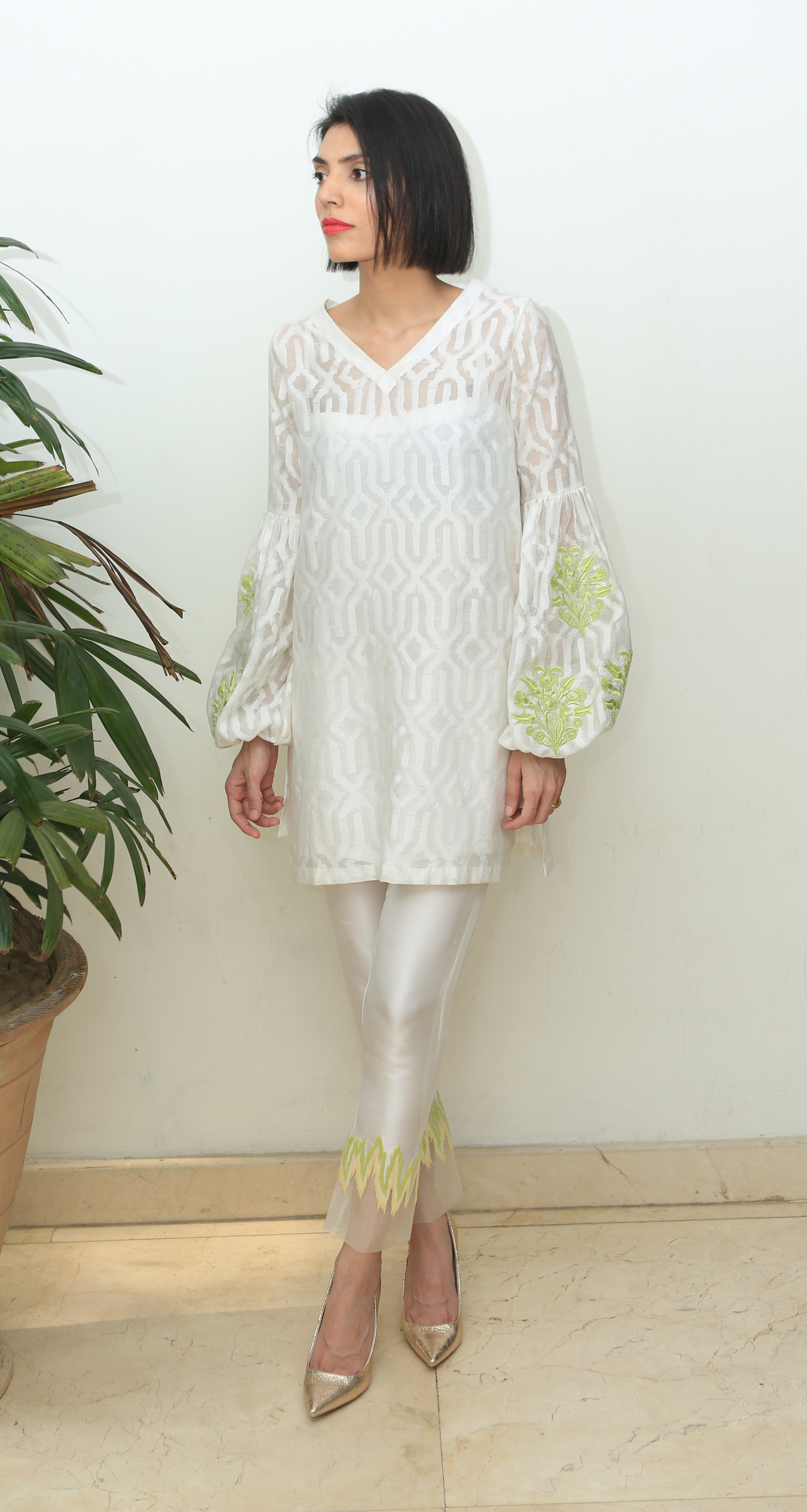 From the sheer fabrics to the hints of neon for a pop of colour, this number is all about the understated glam