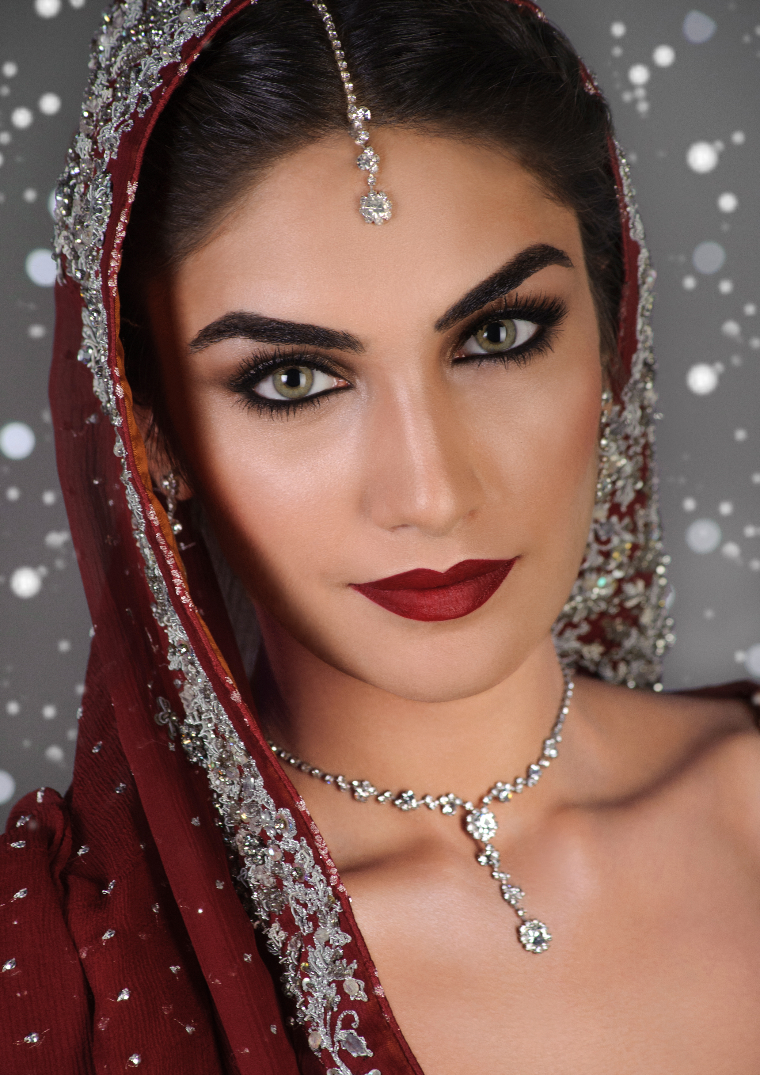 """""""The new Classic""""  Reimagining the tried and true Baraat red lipstick, but pairing it with cool skin and silvery eyes makes for an updated spin on this classic look"""