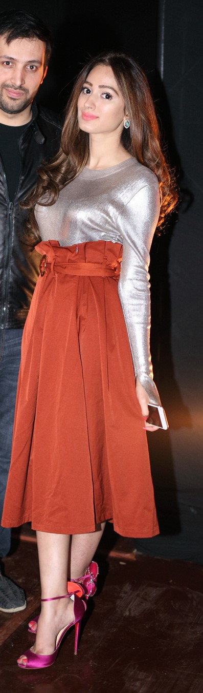 Maliha Ammar - A popping rust coloured flouncy skirt and complimenting shoes make for the perfect night outfit