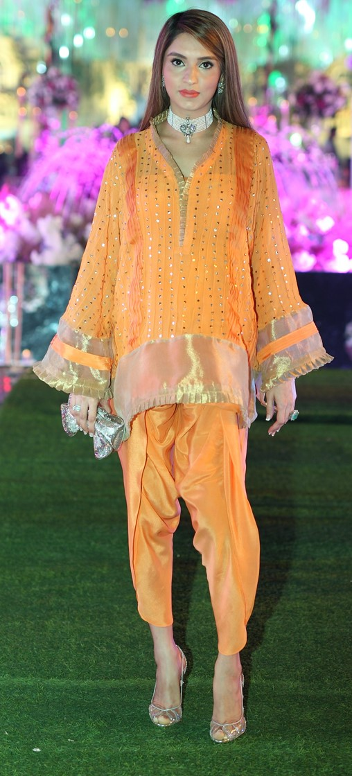 Zehra Saleem - This gorgeous mommy to be wears her all-orange outfit so well