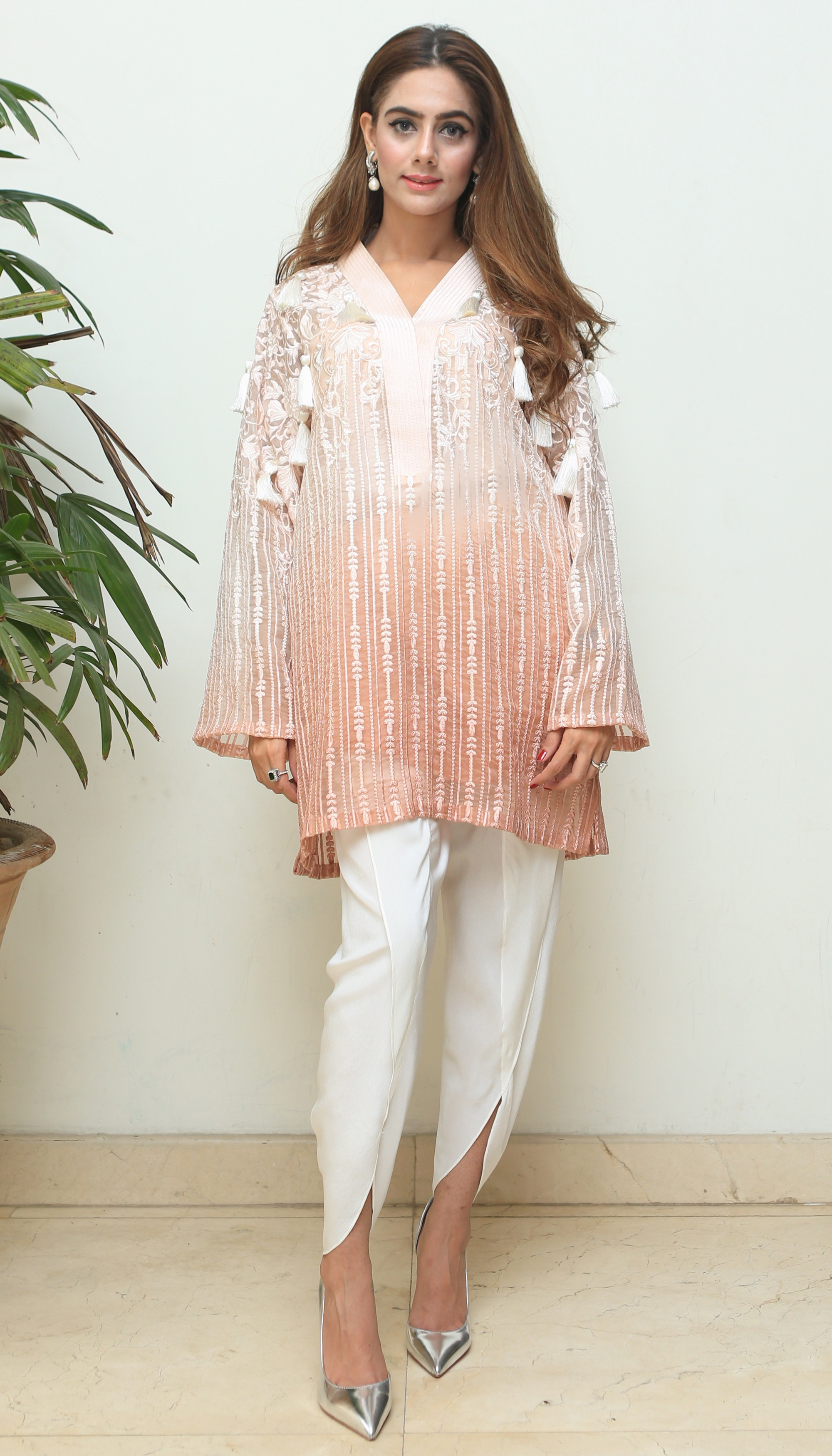 this ombre peach number with tassel detailing hots all the right notes
