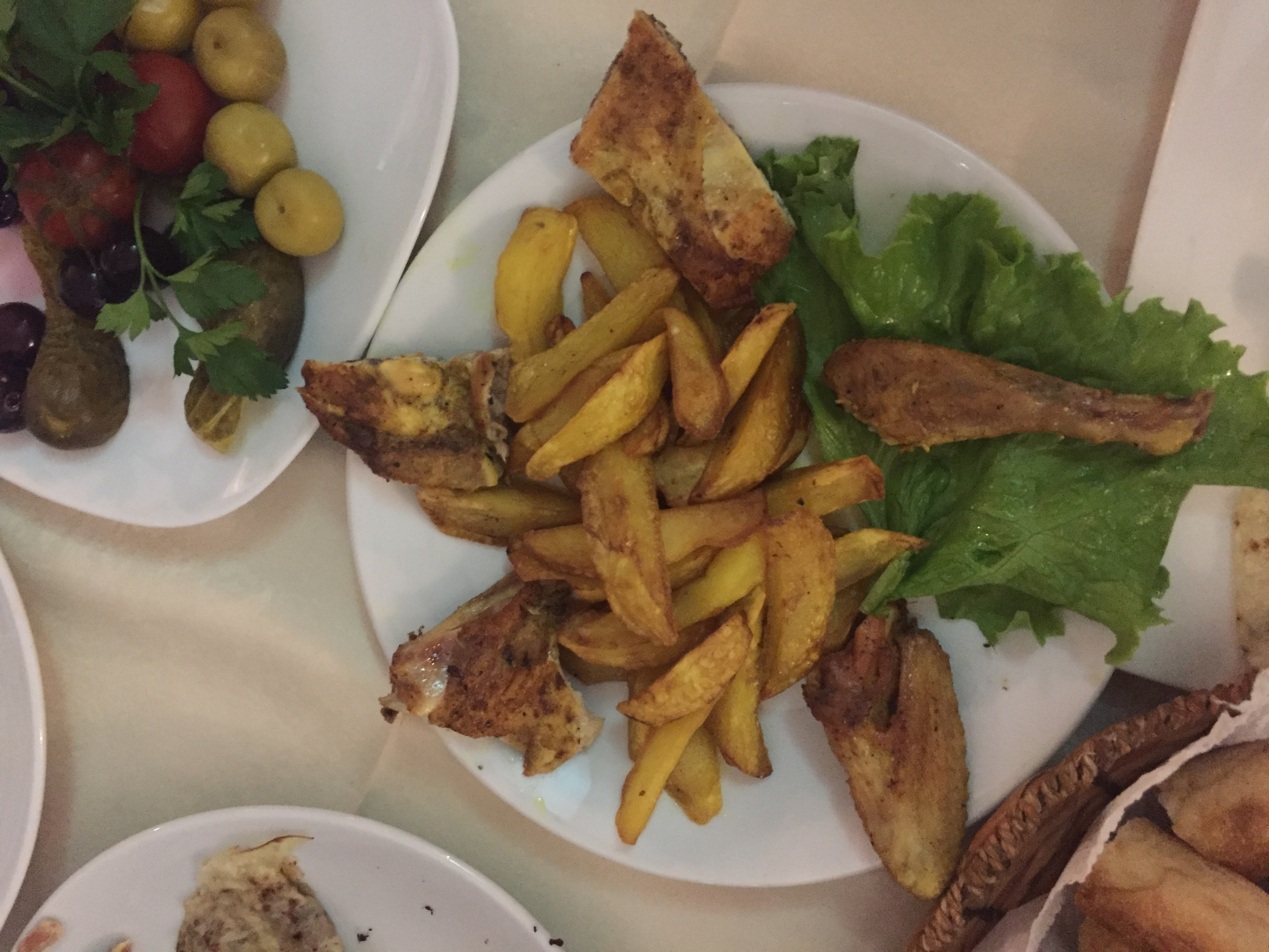 Azerbaijan locals like their meals big and hearty! I couldn't get enough of this roast chicken with spicy potato wedges