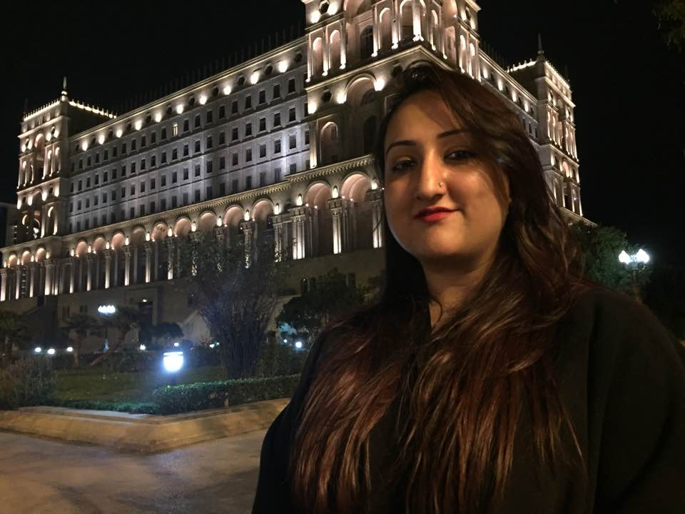 Posing outside King Suleman's Palace, illuminated by a stunning display of lights